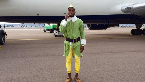 """Cardinals coernerback Patrick Peterson dressed up like Buddy from the movie """"Elf"""" after losing this week's Quarterback Bucket Challenge."""