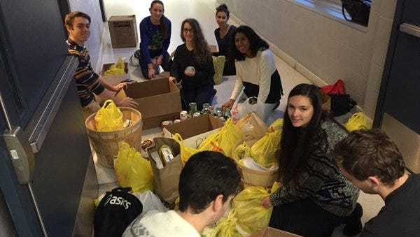 AP calculus students at Buena Regional High School count and organize some of the 3,585 food items collected during the school's annual holiday food drive.