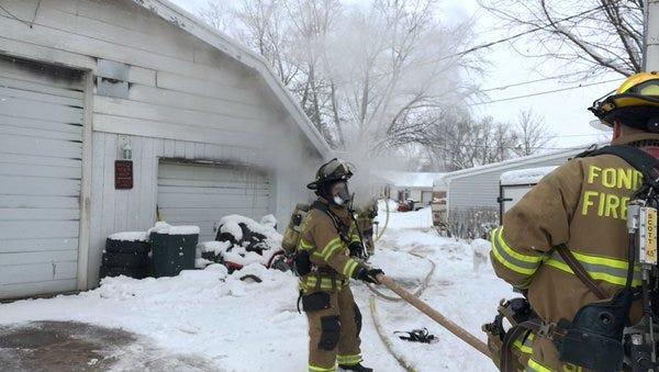 Fond du Lac firefighters battle a garage fire Tuesday at 440 Portage St.
