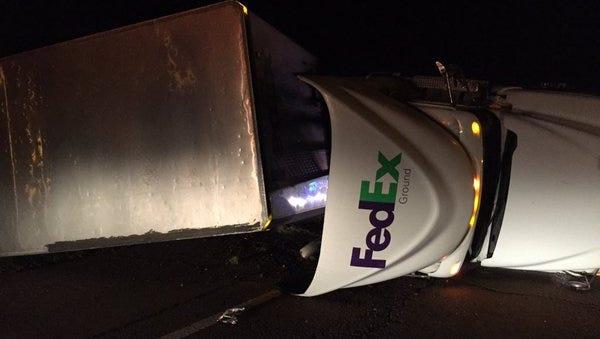 A Fed Ex truck overturned near Gallman Thursday morning.