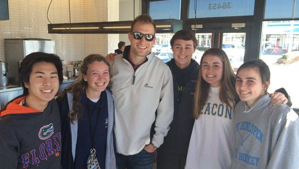 Cape Henlopen students pose with Washington Redskins quarterback Kirk Cousins at a Chipotle near Rehoboth Beach on Wednesday, March 2.