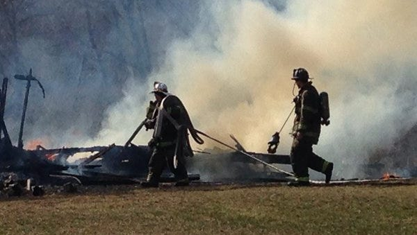 Firefighters fought a blaze at a two-story house in Conewago Township that was sparked by a controlled burn.