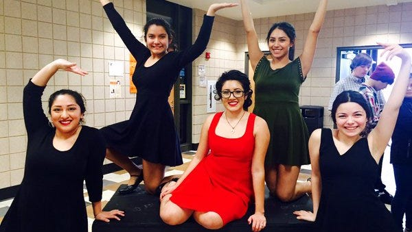 Mercedes Castillo, center in the red dress, fought through the grief of losing her father in a car accident and other challenges to be a star in vocal music and academics at North High School.