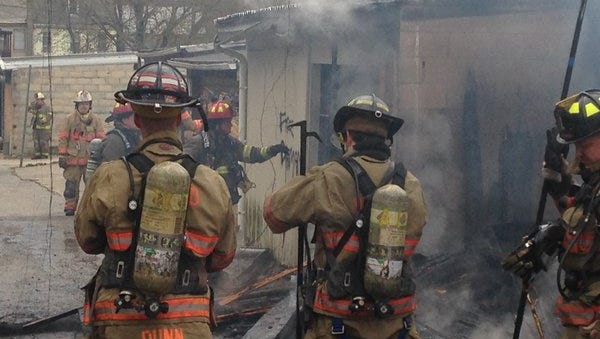 Firefighters work to put out a garage fire Sunday morning on the 400 block of Salem Avenue in York city.