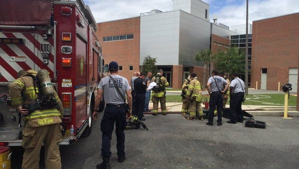 Tallahassee Fire Department crews arrive to an ethylene gas leak at the AME building at Florida State University on Monday.