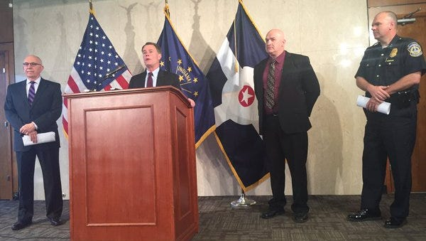 Mayor Joe Hogsett is joined by law enforcement officials at a Thursday morning press conference to announce arrests in a gang investigation.