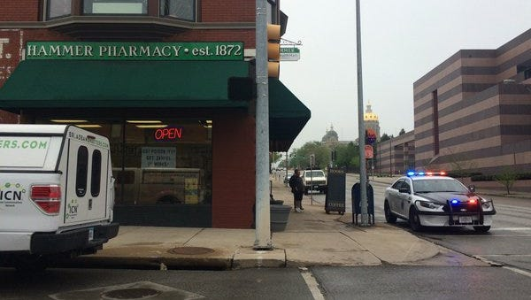 Police investigate an armed robbery April 27, 2016 at Hammer Pharmacy.