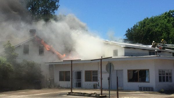 Crews respond to a fire on Main Street in St. Martinville Thursday.