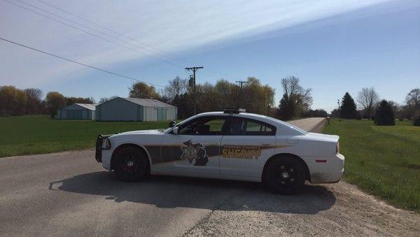 A Sanilac County deputy blocks Galbraith Line Road at Babcock Road in Worth Township. A 19-year-old Lexington man was killed in a crash near St. Clair Road.