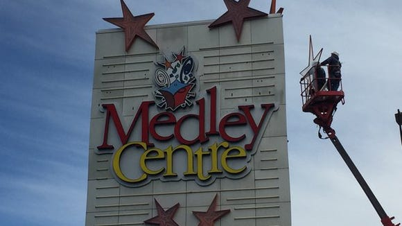The Medley Centre sign is removed from the former Irondequoit Mall on Friday, May 6, 2016.
