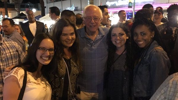 Left to right (not including Bernie Sanders): Sara Mulford, Kamber Fishbein, Quinn D'Andrea and Celeste Butler, all of Los Angeles.