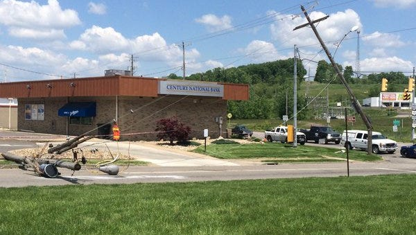 A semi clipped a low electric line, bringing three power poles down in South Zanesville.