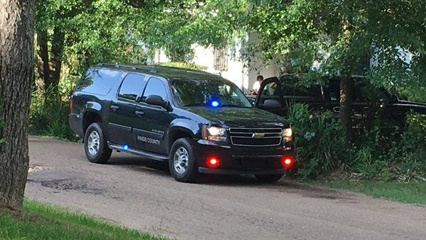 Hinds County Coroner Sharon Grisham Stewart arrives on the scene of a body found underneath a home on Wynwood Drive.