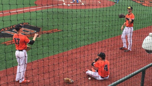 Oregon State players Andy Atwood (left), Steven Kwan (center) and Joe Gillette warm up before a game earlier in the season against UCLA at Goss Stadium.