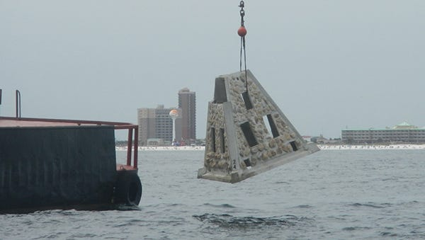 Escambia County workers deploy an artificial reef off of Pensacola Beach.