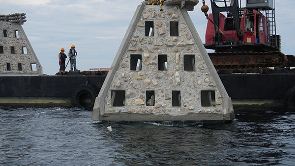 Escambia County workers deploy artificial reef off Pensacola Beach