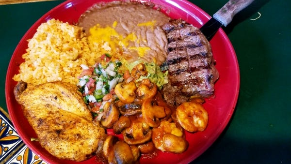 The Sunset Platter at Mayas Grill in Palm City consists of a petite New York strip steak, a well seasoned and seared boneless chicken breast and a saute of shrimp and mushrooms in a tasty brown sauce.