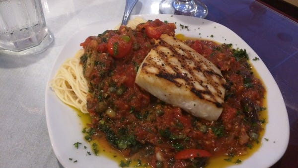 Johnny D's grilled cobia was prepared with grape tomatoes, Kalamata olives, capers and Bermuda onions in a marinara sauce.