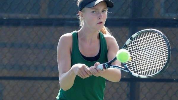 Oshkosh North's Gabrielle Prehn backhands a return playing in the FVA tennis meet Thursday at Oshkosh North High School.