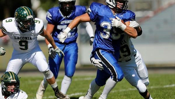 St. Mary's Springs running back Clay Schueffner runs the ball against Laconia at Fruth Field on Saturday in Fond du Lac.