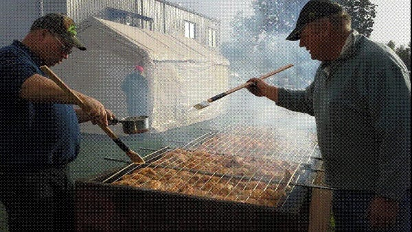 Chicken sizzles up on the grill at the annual Famous BBQ Chicken Dinner at St. Boniface Church.