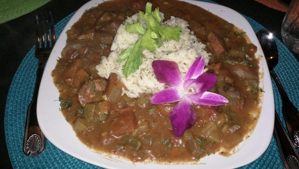 "Étouffée is a French for ""smothered."" At Cajun Cove, order étouffée with a variety of  protein and vegetables in a rich brown, spicy roux on a mound of steamy rice."