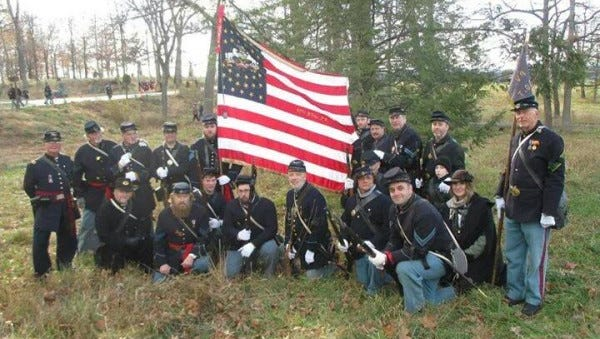 Members of the 87th Pennsylvania reenactors group portray period Union soldiers.
