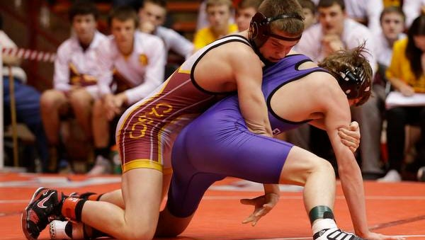 Luxemburg-Casco's Bryce Bosman competes against Jon Cain of Ellsworth at 126 pounds during the WIAA Division 2 state championship match in Madison.