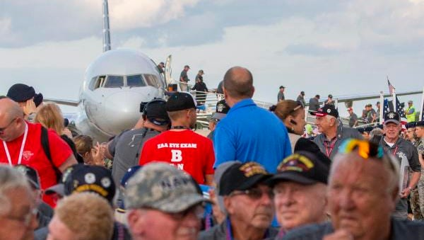 Vietnam veterans exit an American Airlines plane Friday, July 27, 2018, at Wittman Regional Airport in Oshkosh after returning from a Yellow Ribbon Honor Flight to Washington as part of EAA AirVenture 2018.
