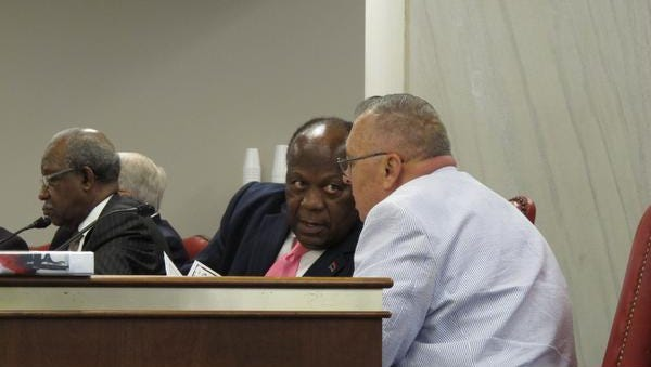 State Sen. Robert Ford, D-Charleston, center, talks to his lawyer, William Runyon, right, during a hearing on ethics charges against him on Thursday, May 30, 2013, in Columbia.