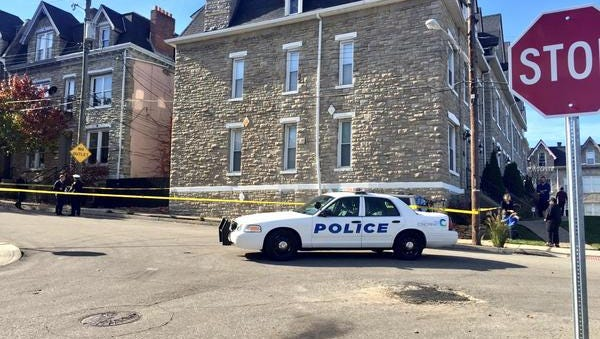 Police investigate after a person was found shot to death in a vehicle in Mount Auburn.