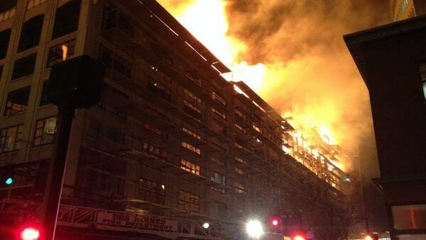 A fire burns in downtown Des Moines.