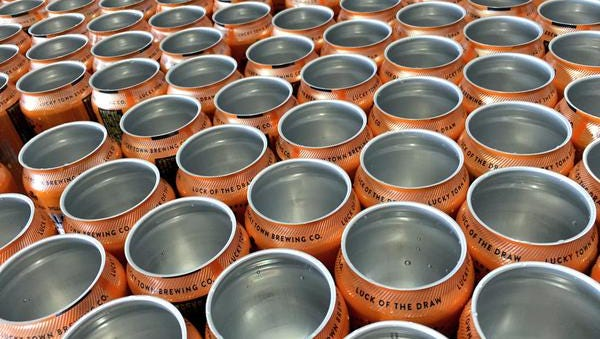 Empty cans await their golden bounty as Lucky Town Brewing Co. kicks off their canning operation.