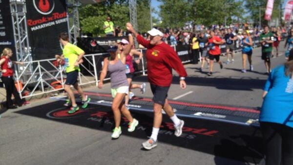 New England Patriots' head coach Bill Belichick crosses the finish line at the 2014 St. Jude Country Music Half Marathon.