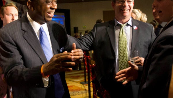 Vernon Parker greets supporters during an election night party at the Hyatt Regency in downtown Phoenix on Nov. 6, 2012. Parker was defeated by Democratic candidate Kyrsten Sinema in Ariz. Congressional District 9.