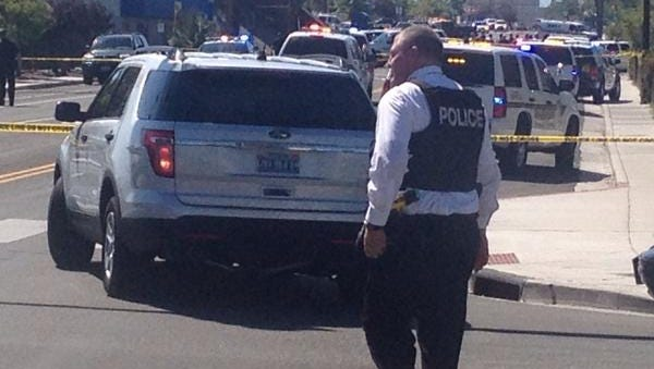 Police officers on the scene of a shooting at Ninth and Sutro streets on Wednesday, Sept. 3, 2014.
