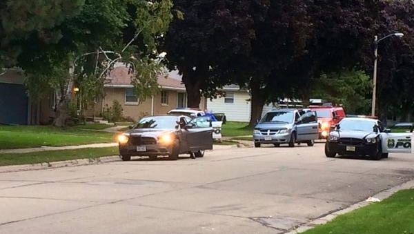 Scene outside a Leo Street home where a bear was in a yard Thursday morning.