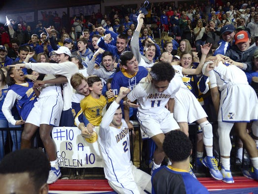 Irondequoit fans and players celebrate their win following
