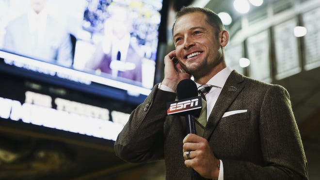 Western Michigan head coach P.J. Fleck is interviewed on a live ESPN broadcast during a bowl announcement watch party in Kalamazoo, Mich., Sunday, Dec. 4, 2016. Western Michigan won the MAC championship to remain undefeated and earned the berth in the Cotton Bowl. (Chelsea Purgahn/Kalamazoo Gazette-MLive Media Group via AP)
