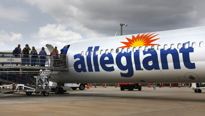 Fliers board an Allegiant jet at the Punta Gorda Airport in Charlotte County in this April photo.