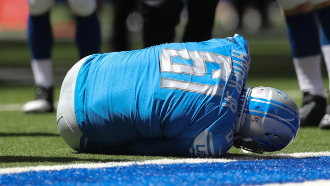 Lions defensive lineman Kerry Hyder Jr. is hurt during the second quarter of the Lions' 24-10 exhibition win over the Colts on Sunday, Aug. 13, 2017, in Indianapolis.