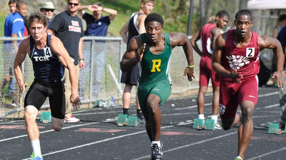 Sprinters compete in the 100-meter dash at the 2014 Mountain Athletic Conference track meet.