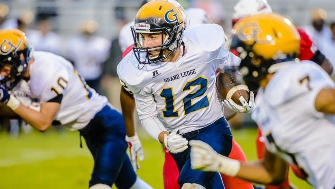 Luke Lalumia of Grand Ledge turns the corner on his way to the endzone for a touchdown in the 1st quarter of the Comets' game with Sexton Friday September 11, 2015 at Sexton High in Lansing. KEVIN W. FOWLER PHOTO