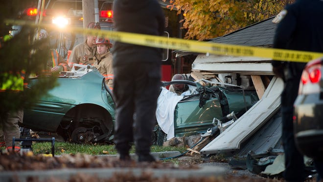 Two people died when a car crashed into a garage on Nov. 8, 2015, near the intersection of 3rd Avenue and Harrison Street in Spring Garden Township.