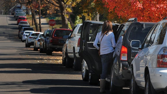 Parallel parking benefits pedestrians, businesses and communities by being a buffer between moving cars and foot traffic.