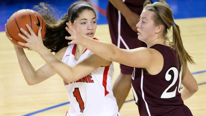 Ursuline's Alisha Lewis (left), shown here being guarded by Concord's Caroline Procak in the semifinals on Wednesday, will be one of the key players in Friday's DIAA girls basketball final against Sanford.