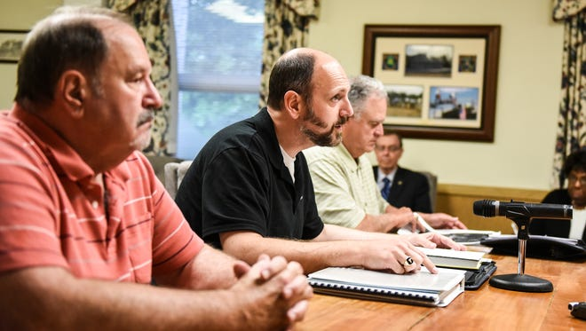 Dr. Rodney Gernert (center) along with Dr. Dennis Tulli (right) and Ron Ricard (left) chairman of the Citizens for Safe Communities, address the Lebanon County Commissioners about a proposed low income housing facility in West Cornwall Township at the Lebanon County Commissioners meeting on Thursday, June 16, 2016.