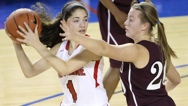 Ursuline's Alisha Lewis (left) - shown here against Concord's Caroline Procak last year - scored 15 points in a season-opening win over the Mary Louis Academy last Saturday.