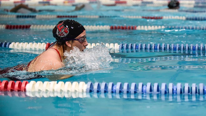 Swimmers compete at the Marion YMCA for the high school swim meet held on Wednesday evening.