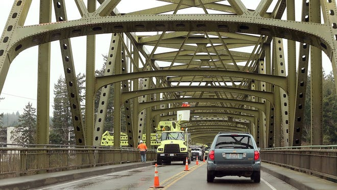 Traffic exiting Bainbridge Island slowly travels over the Agate Pass Bridge as crews work in February 2015.
